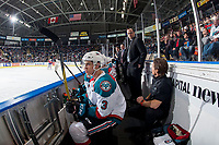 KELOWNA, CANADA - FEBRUARY 17: Kelvin Hair #3 of the Kelowna Rockets sits on the bench as assistant coach Kris Mallette speaks to athletic therapist Scott Hoyer on February 17, 2018 at Prospera Place in Kelowna, British Columbia, Canada.  (Photo by Marissa Baecker/Shoot the Breeze)  *** Local Caption ***