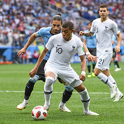 Martin Caceres of Uruguay and Kylian Mbappe of France during 2018 FIFA World Cup Quarter Final match  between France and Uruguay at Nizhniy Novgorod Stadium on July 6, 2018 in Nizhniy Novgorod, Russia. (Photo by Anthony Dibon/Icon Sport)