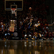 09 December 2017:  The San Diego State men's basketball team hosts the California Golden Bears Saturday afternoon. San Diego State Aztecs forward Jalen McDaniels (5) attempts a shot over California Golden Bears center Kingsley Okoroh (22) in the first half. The Aztecs trail 39-34 at halftime.<br /> www.sdsuaztecphotos.com