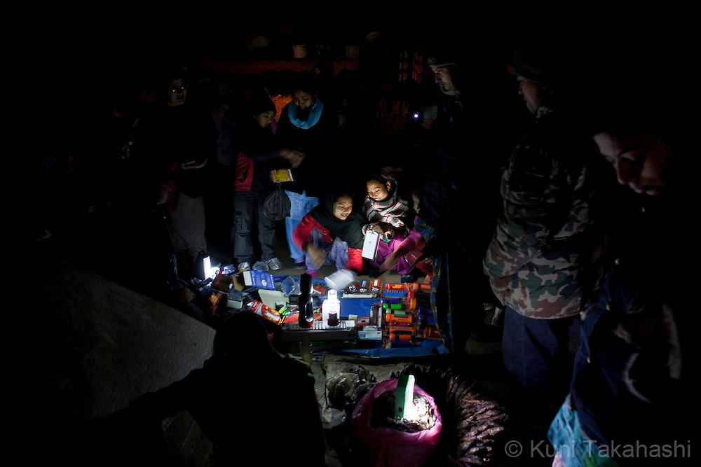 (Jan 4, 2012 - Kathmandu, Nepal).People buy flashlights at an outdoor market during power outage in Kathmandu, Nepal, on Jan 4, 2012. For the last several years, nearly 800,000 people of the capital city faced up to 16 hours of blackouts every day, mainly caused by political instability. Nepal is said to be second only to Brazil in terms of water resources but the government has been incapable of harnessing hydropower..(Photo by Kuni Takahashi)