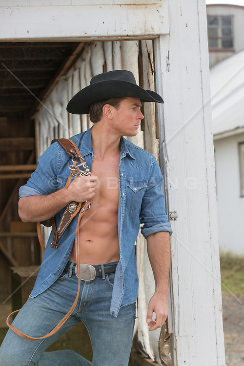 hot cowboy with an open shirt on a ranch