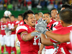 15.07.2011, Ernst Happel Stadion, Wien, AUT, American Football WM 2011, Japan (JAP) vs Mexico (MEX), im Bild Naoki Maeda   (Japan, #11, QB, WR) gets celebrated by his team for the win of the MVP // during the American Football World Championship 2011 game, Japan vs Mexico, at Ernst Happel Stadion, Wien, 2011-07-15, EXPA Pictures © 2011, PhotoCredit: EXPA/ T. Haumer