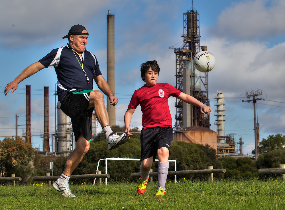 Simon Dew &amp; son Lucas who suffers from asthma which is made worse in industrial locations. In the background is the Altona Oil Refinery. Pic By Craig Sillitoe CSZ / The Sunday Age.21/07/2012 melbourne photographers, commercial photographers, industrial photographers, corporate photographer, architectural photographers, This photograph can be used for non commercial uses with attribution. Credit: Craig Sillitoe Photography / http://www.csillitoe.com<br />
