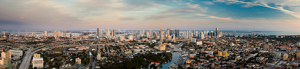 Wide aerial panorama of the Miami skyline from the west with the Miami River and Dolphin Expressway in the foreground.  This version is watermarked, contact us to license and clean version.