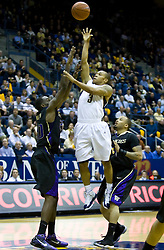 February 11, 2010; Berkeley, CA, USA;  California Golden Bears guard Jerome Randle (3) shoots over Washington Huskies forward Quincy Pondexter (20) during the first half at the Haas Pavilion.  California defeated Washington 93-81.