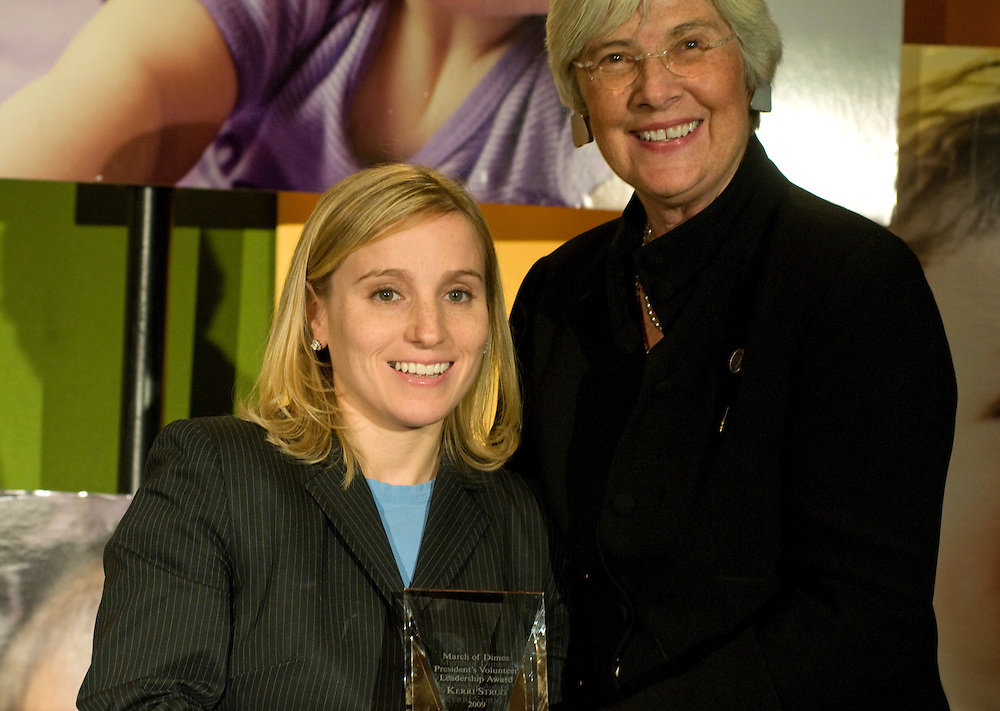 DISTRICT OF COLUMBIA: Oct. 8, 2009 -- Olympic gold medalist Kerri Strug is honored with the March of Dimes Volunteer Leadership award for helping to raise public awareness, which was presented by Dr. Jennifer L. Howse, President of the March of Dimes.  Strug is a longtime supporter of the March of Dimes' efforts to fight prematurity and birth defects.   Photo by Johnny Bivera