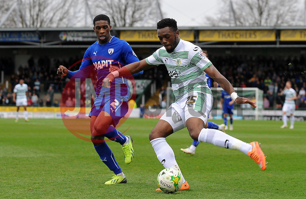 Yeovil Town's Gozie Ugwu is tackled by Chesterfield's Tendayi Darikwa - Photo mandatory by-line: Harry Trump/JMP - Mobile: 07966 386802 - 03/04/15 - SPORT - FOOTBALL - Sky Bet League One - Yeovil Town v Chesterfield - Huish Park, Yeovil, England.