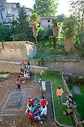 Viterbo, Italy. Kids hanging out in a park.