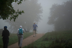 © London News Pictures. 16/10/2013. London, UK.  A runner in thick fog on Parliament Hill in Hempstead, North London. Parts of the UK have woken to thick fog this morning. Photo credit: Ben Cawthra/LNP