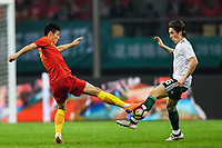 Harry Wilson, right, of Wales national football team kicks the ball to make a pass against a player of Chinese national men's football team in the semi-final match during the 2018 Gree China Cup International Football Championship in Nanning city, south China's Guangxi Zhuang Autonomous Region, 22 March 2018.