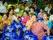 """26 NOVEMBER 2014 - BANGKOK, THAILAND: People watch a Chinese opera performance at the Chow Su Kong Shrine in the Talat Noi neighborhood of Bangkok. Chinese opera was once very popular in Thailand, where it is called """"Ngiew."""" It is usually performed in the Teochew language. Millions of Chinese emigrated to Thailand (then Siam) in the 18th and 19th centuries and brought their culture with them. Recently the popularity of ngiew has faded as people turn to performances of opera on DVD or movies. There are about 30 Chinese opera troupes left in Bangkok and its environs. They are especially busy during Chinese New Year and Chinese holidays when they travel from Chinese temple to Chinese temple performing on stages they put up in streets near the temple, sometimes sleeping on hammocks they sling under their stage.      PHOTO BY JACK KURTZ"""