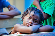 Girl in an orphanage in Port-au-Prince Haiti where all the kids reside outside under blue plastic tarts, since the earthquake hit Haiti on January 12, 2012. The magnitude 7.7 earthquake on January 12, 2010 which caused widespread devastation, killed over 200,000 people and left over a million people homeless.