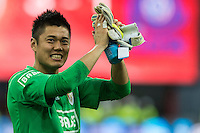20131215 - LEUVEN, BELGIUM: Standard's goalkeeper Eiji Kawashima greets the public after winning the Jupiler Pro League match between Standard de Liege and KRC Genk, in Liege, Sunday 15 December 2013, on the nineteenth day of the Belgian soccer championship. BELGA PHOTO JASPER JACOBS