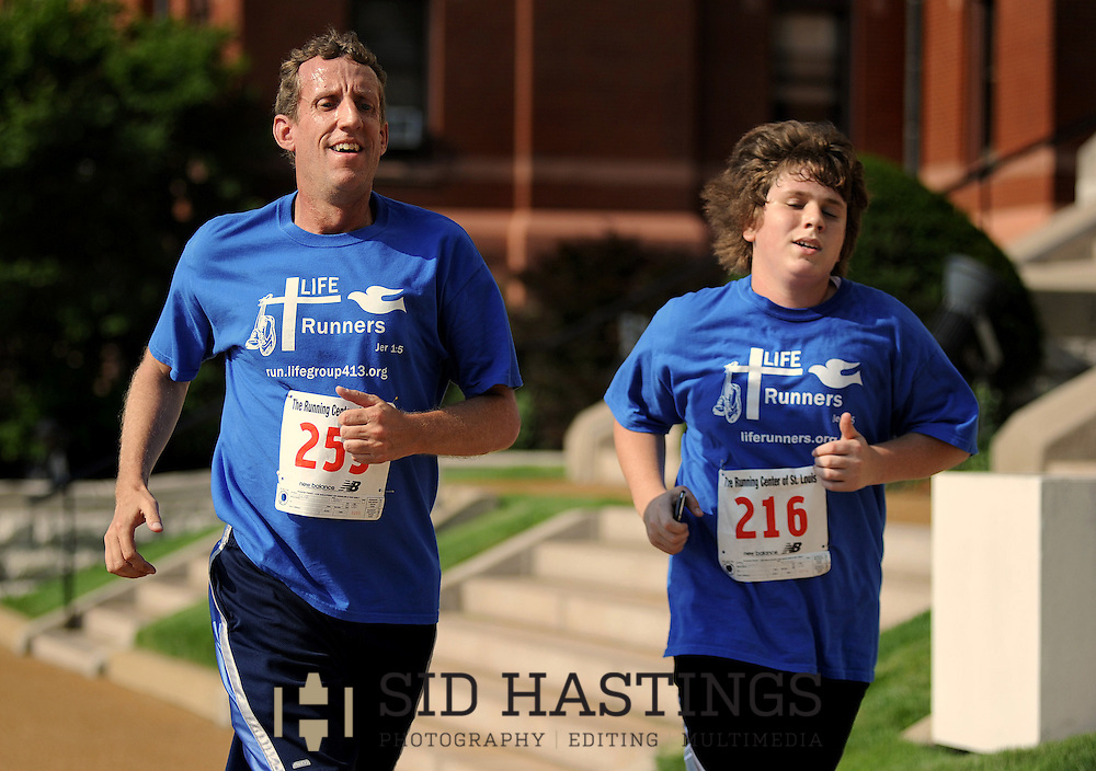 5 MAY 2012 -- ST. LOUIS. -- LIFE Runners team members Dan Hinrichs (255) and Michael Laugeman (216) compete in the St. Louis University 2012 Run for Their Lives 5K Run/Walk on the SLU campus in St. Louis Saturday, May 5, 2012. Proceeds from the race benefitted SLU's Pregnant and Parenting Student Assistance fund. Photo © copyright 2012 Sid Hastings.