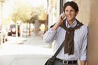 Man using mobile phone in street