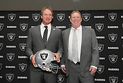 Jan 9, 2018; Alameda, CA, USA; Jon Gruden (left) poses with Oakland Raiders owner Mark Davis after being introduced as head coach at a press conference at the Raiders headquarters.