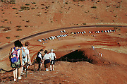 Tourists make the descent from Ayer's Rock (Yulara). Central Australia.