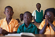 Hassana Ibrahim, 11, (standing) is standing up in order to answer the teacher's question while attending lessons in her school in Boggu, Tamale, northern Ghana.