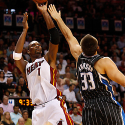 March 3, 2011; Miami, FL, USA; Miami Heat power forward Chris Bosh (1) shoots over Orlando Magic power forward Ryan Anderson (33) during the fourth quarter at the American Airlines Arena. The Magic defeated the Heat 99-96.    Mandatory Credit: Derick E. Hingle