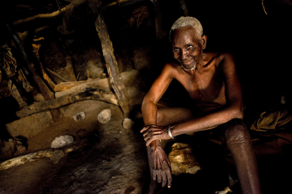 Old man sits by his hut in his village of Cotonou, Benin February 25, 2008.