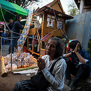 Family memeber gather to attend the three day funeral of Sud Chumpu of Pra Mok, Thailand.  Sud's funeral was attended by the entire village.
