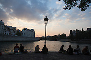 France. Paris  People gathering on Saint louis island  quay at dusk,