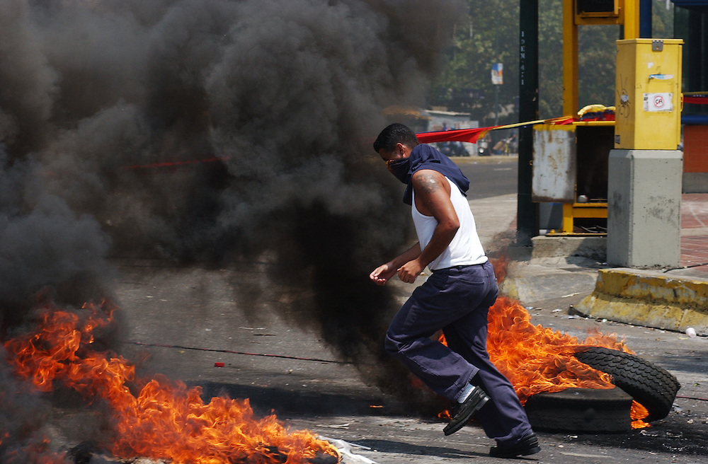 Anti-government protestors flee as the National Guard fires rubber bullets and tear gas as riots continued in Caracas between the two groups. The country is awaiting a preliminary decision on the validity of signatures seeking a recall referendum.  It is expected that hundreds of thousands of signatures will have to go to a review process that the opposition will refuse to submit to.
