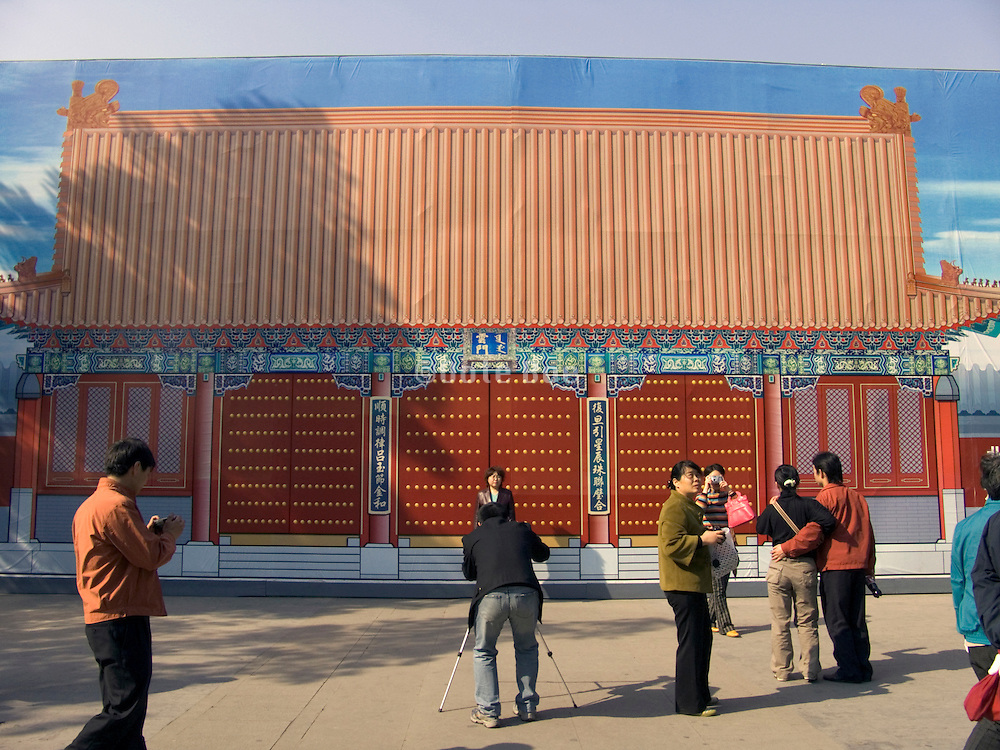 people photographing against a painted pavilion backdrop Summer Palace Beijing