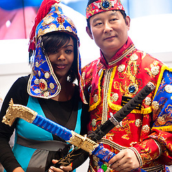 Milan, Italy - February  17: An ethiopian girl and a Korean man at BIT International Tourism Exchange on february 17, 2012 in Milan, Italy.