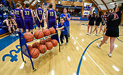 6-year-old Joey Rankin races the ball cart back to the closet as his mom Chelse walks behind him as Kadoka Area and Lyman prepare for the start of their game during the 50th Jones County Invitational Tournament on Thursday in the Harold Thune Auditorium in Murdo. (Matt Gade / Republic)