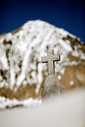 "SHOT 3/16/10 5:07:06 PM - A headstone peeks out from beneath some deep snow at the Crested Butte Cemetery in Crested Butte, Co. The Crested Butte Cemetery was established in 1879 and is located about 1/2 mile northeast of the town of Crested Butte. The cemetery is located in a spectacular setting with the rugged beauty of Mt. Crested Butte as a backdrop. The cemetery is a great place to get a sense of the history of the area and many graves are those of miners from the early days of Crested Butte. Crested Butte is a Home Rule Municipality in Gunnison County, Colorado, United States. A former coal mining town now called ""the last great Colorado ski town"", Crested Butte is a destination for skiing, mountain biking, and a variety of other outdoor activities. .(Photo by Marc Piscotty / © 2010)"