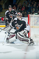 KELOWNA, CANADA - JANUARY 7: Cody Porter #35 of Vancouver Giants keeps his eye on the airborne puck against the Kelowna Rockets  on January 7, 2015 at Prospera Place in Kelowna, British Columbia, Canada.  (Photo by Marissa Baecker/Shoot the Breeze)  *** Local Caption *** Cody Porter;