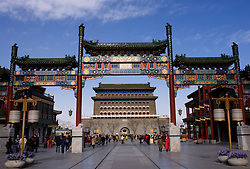 New ornate gate in traditional style built across recently built historic tourist street in Qianmen Beijing China