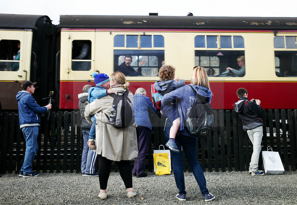 © Licensed to London News Pictures. <br /> 01/10/2016. <br /> Grosmont, UK.  <br /> <br /> Visitors and steam railway enthusiasts look on as carriages are pulled by a steam locomotive during the North Yorkshire Moors Railway Autumn Steam Weekend. <br /> The hugely popular railway line runs a service between Pickering and Whitby through the picturesque North yorkshire countryside and attracts thousands of visitors each year. <br /> <br /> Photo credit: Ian Forsyth/LNP