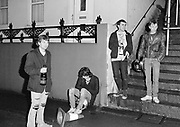 A group of lads hanging out on a saturday night, Guernsey, Christmas 1985