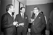 "4/03/1966<br /> 03/24/1966<br /> 24 March 1966<br /> Reception at the Shelbourne Hotel for speakers at the Symposium on ""Shock"" sponsored by Pharmacia International held at UCD. Image shows (l-r): Dr R.H. (R.M.?) Rousell, Medical Advisor, Pharmacia (Great Britain); Mr Liam Porter, Manager, Pharmaceutical Division, Goodbody's Ltd. and Mr M.B. Pearson, Field Sales Manager, Pharmacia, Great Britain."