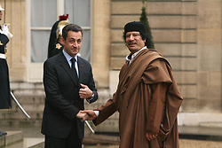 File photo - Libyan leader Moammar Gadhafi shakes hands with President Nicolas Sarkozy before their meeting at the Elysee Palace in Paris, France on December 10, 2007. Gadhafi is on a 5-Day State Visit to France for a high-profile visit set to usher in multi-billion-euro nuclear and aviation contracts. Former French President Nicolas Sarkozy was in police custody on Tuesday morning March 20, 2018, an official in the country's judiciary said. He was to be questioned as part of an investigation into suspected irregularities over his election campaign financing, the same source added. The probe related to alleged Libyan funding for Sarkozy's 2007 campaign, Le Monde newspaper reported. Photo by Abd Rabbo-Mousse/ABACAPRESS.COM