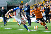 Blackburn Rovers defender Shane Duffy tracks Wolverhampton Wanderers striker Adam Le Fondre  during the Sky Bet Championship match between Wolverhampton Wanderers and Blackburn Rovers at Molineux, Wolverhampton, England on 9 April 2016. Photo by Alan Franklin.