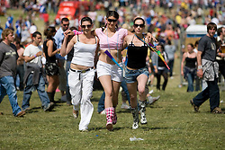 Stacey Devlin, Emma McAllister and Vicky Newlands head towards the main stage. Rockness, Sunday 8th June 2008..Pic © Michael Schofield. All Rights Reserved.