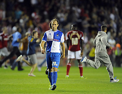 Bristol Rovers' Mark McChrystal walks off the pitch as Bristol city fans celebrate their win  - Photo mandatory by-line: Joe Meredith/JMP - Tel: Mobile: 07966 386802 04/09/2013 - SPORT - FOOTBALL -  Ashton Gate - Bristol - Bristol City V Bristol Rovers - Johnstone Paint Trophy - First Round - Bristol Derby
