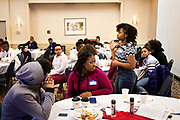 Jentarria Bey, right, poses a question during the Black Excellence Youth Conference at the Best Western Plus Inntowner on Monday, Jan. 15, 2018.