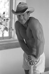 cute shirtless cowboy in boxer shorts