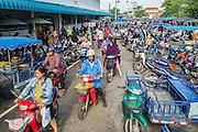 25 OCTOBER 2012 - PATTANI, PATTANI, THAILAND: People drive into the market in Pattani, Thailand.      PHOTO BY JACK KURTZ