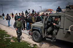 © London News Pictures. 14/03/2011. Israeli soldiers intercept a protest march in the Palestinian village of Al ma' sara in the occupied West Bank. Villagers are protesting against the continued building of Israeli settlements on Palestinian land. 13/03/11
