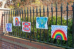 ©Licensed to London News Pictures 26/03/2020  <br /> Sidcup, UK. A positive vibes rainbow and butterflies outside a home in Sidcup, South East London. Children are putting up colourful rainbow artwork on their homes to show gratitude and support for NHS workers. credit:Grant Falvey/LNP