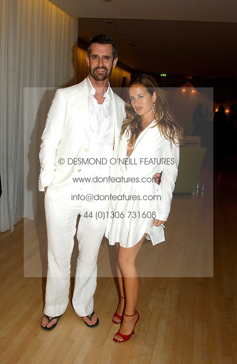RUPERT EVERETT and JADE JAGGER at a party at The Sanderson Hotel on 9th June 2005 to launch 50 Gramercy Park North - Ian Schrager's show-stopping new residential project in New York City. Schrager, with the help of UK architect John Pawson, is building a block of 23 original residences facing Gramercy Park, inbetween two blocks of the Gramercy Park Hotel. <br />