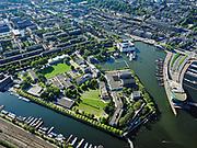 Nederland, Noord-Holland, Gemeente Amsterdam; 02-09-2020; Kattenburg, Dijksgracht en Oosterdok. Marineterrein (Marine Etablissement Amsterdam) en Scheepvaartmuseum. Rechts de ingang van IJtunnel, met  Nemo Science Museum <br /> Eastern Dock with new hotspot former Navy yard.<br /> <br /> luchtfoto (toeslag op standaard tarieven);<br /> aerial photo (additional fee required)<br /> copyright © 2020 foto/photo Siebe Swart