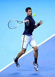 Serbia's Novak Djokovic in action against Austria's Dominic Thiem during day one of the Barclays ATP World Tour Finals at The O2, London.