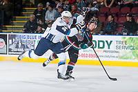 KELOWNA, CANADA - DECEMBER 3: Garrett Armour #34 of Saskatoon Blades checks Riley Stadel #3 of Kelowna Rockets on December 3, 2014 at Prospera Place in Kelowna, British Columbia, Canada.  (Photo by Marissa Baecker/Shoot the Breeze)  *** Local Caption *** Garrett Armour; Riley Stadel;