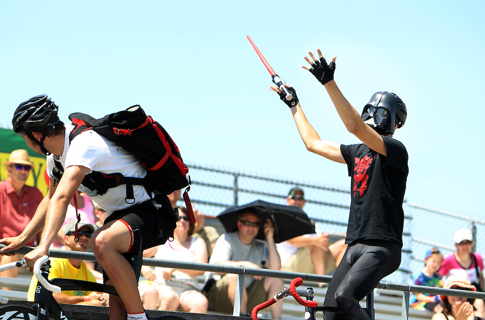 Samuel Hortsmann of Zurich, Switzerland, wears a Darth Vader mask for the light-hearted Trackstand Competition during the Fixed Gear Classic, part of the Nature Valley Bicycle Festival, at the National Sports Center Velodrome in Blaine, Minnesota.  In the event, riders attempt to remain balanced and unmoving on their bicycles.